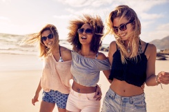 Group of beautiful young women strolling on a beach